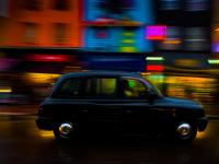 Black Cab in the Gloom of late Afternoon : Camden High Street : London UK