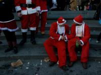 Two Santas Shake Santacon : Washington Sq : New York City