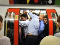 Jamming into the Tube Train : Piccadilly Circus : London