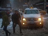 Snow Pedestrians and Taxis : 40th and 8th : New York City